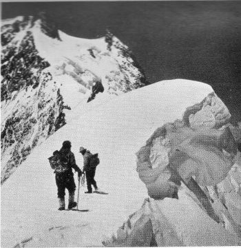 On the 'Firn' ridge near the site of camps VI (1934). The 'Moor's Head is seen a little to the left and above the centre of the view. The 'Silver Saddle' is outlined against the sky. 22nd July 1938