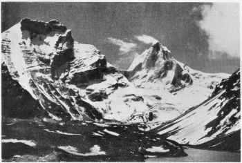 View southwards from 16,000 feet on Kedar Ganga glacier of Phating Pithwara peak, 22,650 feet. Glacier lake in right foreground. Map 53J/NE. 24TH JUNE 1939