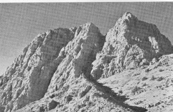 Final crags of Tukatu, East Peak. The Grand Arete climb, about 1,500 feet, is up the central bastion. The crags are fireshortened owing to the tilt of the camera