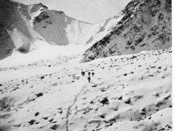 Crossing the Nanda Ghunti glacier to the basin; 17,000-ft. col in centre background
