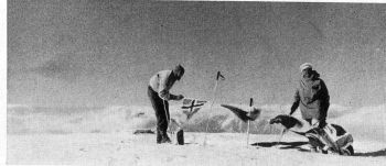 Naess and Streather on the summit, planting flags of Norway, Pakistan, the United Nations, and Great Britain