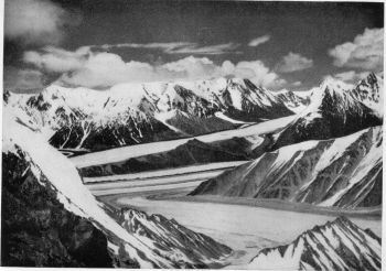 View East from summit of towitz peak. Lolofond Glacier (foreground), Teram Shehr Glacier (background), Unite with Siachen glacier. 'Lost' Oasis, offshoot of Teram Shehr, is right of centre.