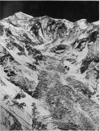 Rakaposhi, 25,550 ft., seen from the west at about 16,000 ft., S.W. spur on skyline; Monk's head extreme right.