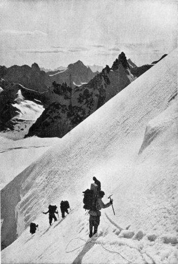 porters descending the ice-slope below the pass where a fixed koim was placed