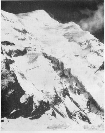 fore summit of ghustung north with glacier route followed between camps i, ii and iii. camp ii below open slopes. camp iii over shoulder to left. (James Roberts)
