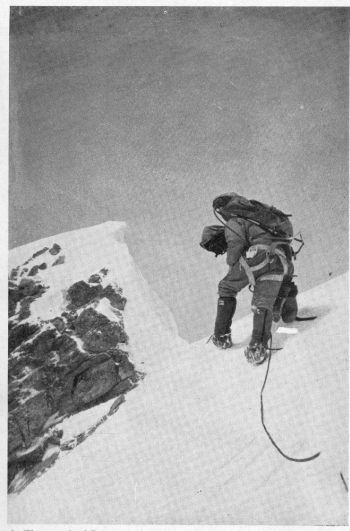 The summit of Everest at about 2 p.m. on 16th May 1976. The climber is Lane. No sign of the Chinese theodolite stand, last seen in September 1975.