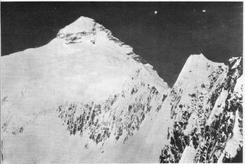Summit Pyramid of k2 from near ridge. Camp 4 was locked in notch beyond the prominent ice tower.  (Photo: James Wickwire)