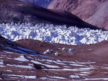 Base camp at 4920 m with the fascinating ice-penitents of Thangman glacier behind. (Colonel Ashok Abbey)